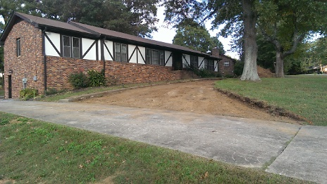 New circular driveway being connected to current driveway