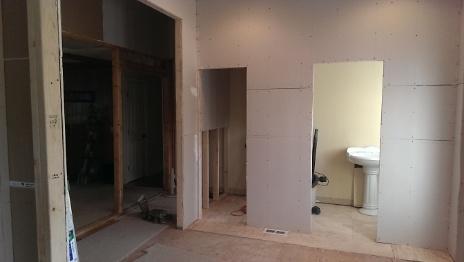 New Powder Room in Foyer Framed In