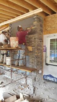 Stone Being Applied to Fireplace